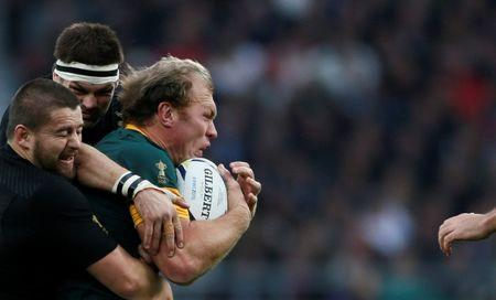 Schalk Burger of South Africa is tacked by Richie McCaw of New Zealand during their Rugby World Cup Semi-Final match at Twickenham in London