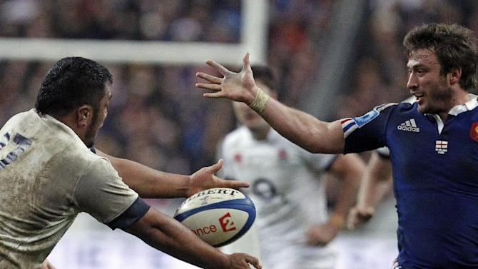 England's Mako Vunipola, left, and France's Maxime Medard, vie for the ball, during their Six Nations rugby union international match, at the Stade de France, in Saint Denis, outside Paris, Saturday, Feb 1, 2014. France defeated England 26-24. (AP Photo/Thibault Camus)