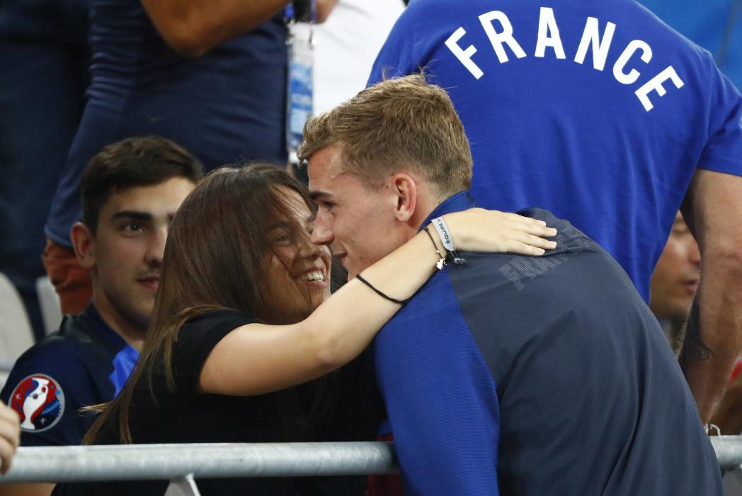 France's Antoine Griezmann with family and freinds after the match