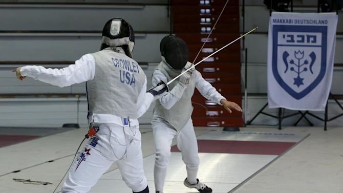 Competitors from the U.S. and Ukraine competes in a fencing comeption during the 14th European Maccabi Games at the Olympic park in Berlin