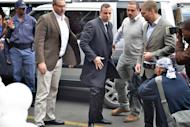South African Paralympic track star Oscar Pistorius arrives at Court in Pretoria on April 14, 2014