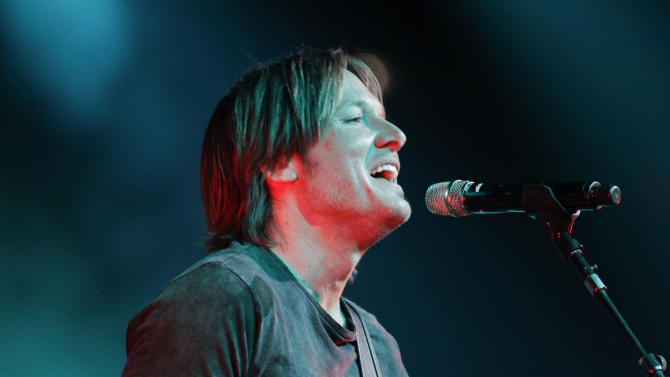 Keith Urban performs during the All for the Hall concert on Tuesday, April 10, 2012, in Nashville, Tenn. The concert is a benefit for the Country Music Hall of Fame and Museum. (AP Photo/Mark Humphrey)