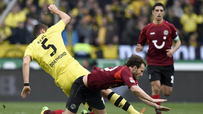 Hanover 96's Huszti and Borussia Dortmund's Kehl fight for the ball during their German Bundesliga first division soccer match in Hanover