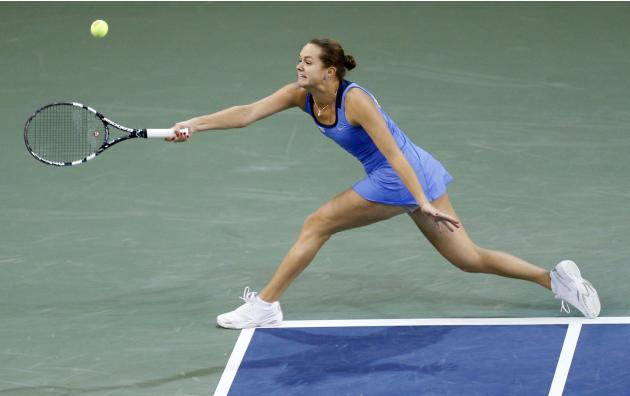 Slovakia's Cepelova plays a shot against Canada's Bouchard during their Fed Cup tennis match in Quebec City