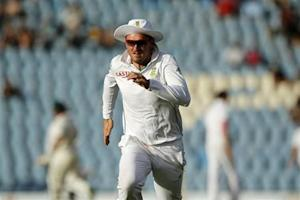 South Africa's captain Graeme Smith runs after a ball after he failed to make a catch during the third day of their test cricket match against Australia in Centurion February 14, 2014. REUTERS/Siphiwe Sibeko