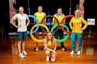 Australian Olympic athletes (from L) Cate Campbell, Craig Mottram, Sally Pearson, Mitchell Watt and Jessica Schipper pose during the unveiling of the Australian Olympic team uniforms at Sydney Olympic Park, in March