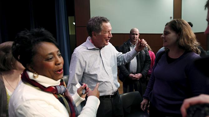 U.S. Republican presidential candidate and Ohio Governor John Kasich greets supporters after a town hall meeting at Francis Marion University in Florence