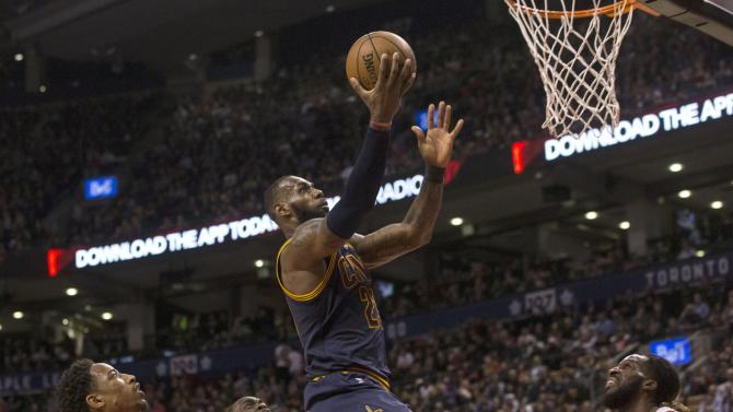 Cleveland Cavaliers forward LeBron James, center, scores on the Toronto Raptors defense during second half NBA basketball action in Toronto on Monday, Dec. 5, 2016. (Chris Young/The Canadian Press via AP)