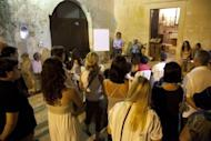 Philosopher Graziella Luppo (back, C) leads a philosophy debate in the village of Corigliano d'Otranto in southern Italy. Socrates, Plato and Aristotle are the new unlikely heroes of a remote Italian town where local authorities are promoting philosophical thinking for a better way of life