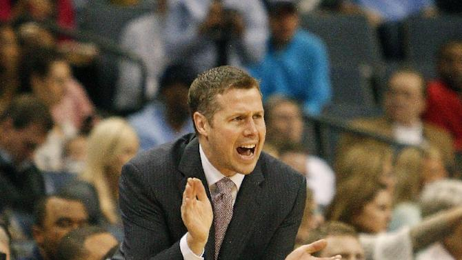 Memphis Grizzlies head coach Dave Joerger calls a play against the Milwaukee Bucks in the first half of an NBA basketball game on Saturday, Feb. 1, 2014, in Memphis, Tenn