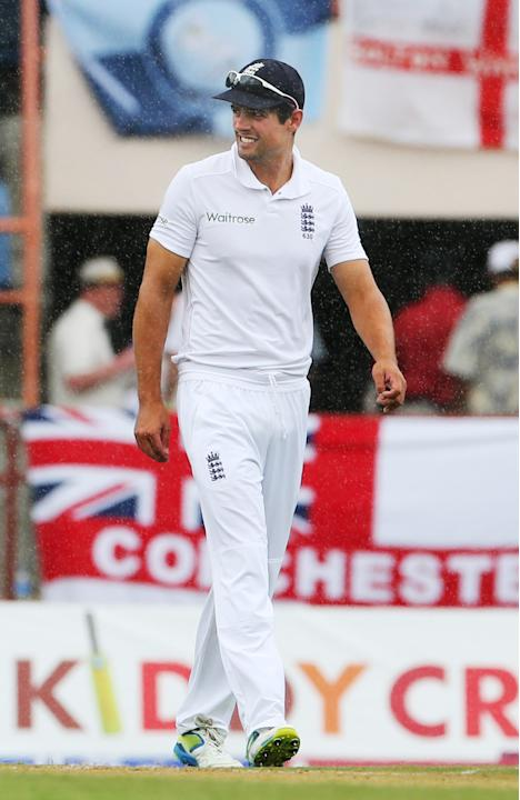 Cricket: England's Alastair Cook walks off as rain halts play