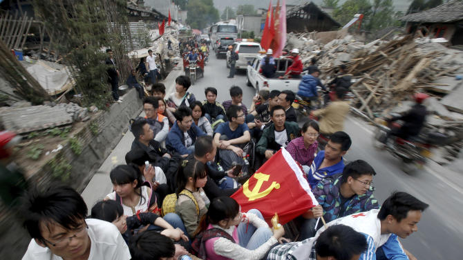 People ride a truck as they are evacuated from the quake ravage Longmen township in Lushan county in southwest China's Sichuan province Sunday, April 21, 2013. Saturday's earthquake in Sichuan province killed over 200 people, China's Xinhua News Agency said. (AP Photo) CHINA OUT