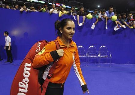 Micromax Indian Aces' Sania Mirza of India arrives on court for her warm-up at the International Premier Tennis League (IPTL) in Singapore