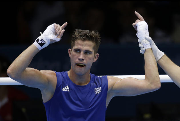 FILE.-  In this Aug. 3, 2012 file photo, France's Alexis Vastine reacts after defeating Mongolia's Tuvshinbat Byamba in a men's welterweight 69-kg preliminary boxing match at the 2012 Summ
