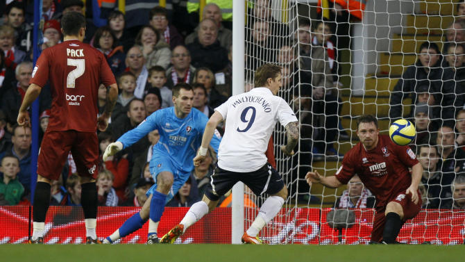 Tottenham Hotpurs' Roman Pavlyuchenko, center, scores against Cheltenham Town during their English FA Cup third round soccer match at White Hart Lane Stadium in London, Saturday Jan. 7, 2012. (AP Photo/Kirsty Wigglesworth)