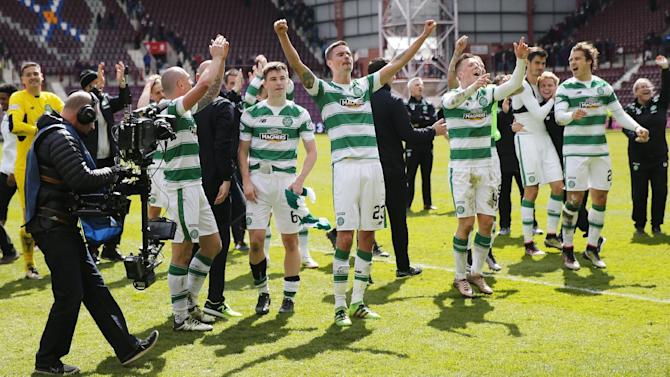 Celtic players celebrate winning the Ladbrokes Scottish Premiership at the end of the game