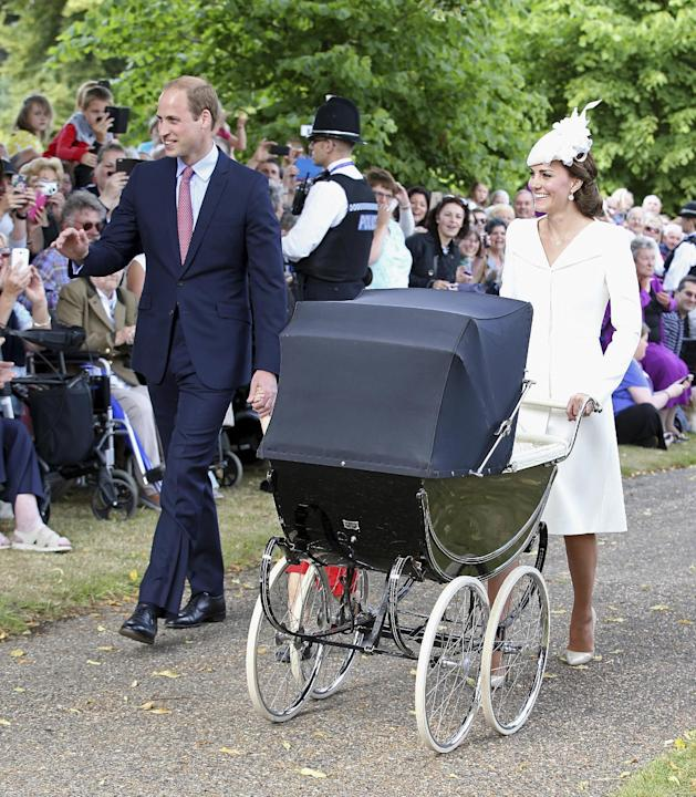 Britain's Prince William and his wife Catherine, Duchess of Cambridge, arrive with their son Prince George and daughter Princess Charlotte for her christening
