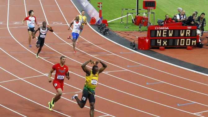 Jamaica's Usain Bolt celebrates after he won gold ahead of Ryan Bailey of the U.S. in the men's 4x100m relay final at the London 2012 Olympic Games
