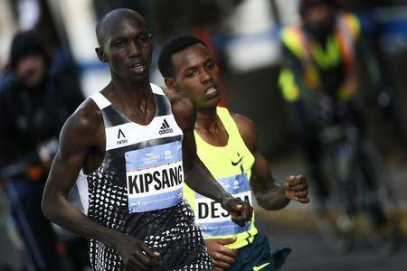 Men's champion Kipsang of Kenya leads elite's runners while they make their way across Manhattan during the New York City Marathon in New York