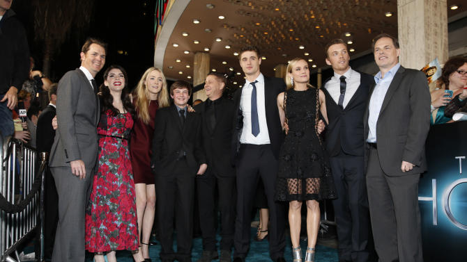 "Open Road Film's Jason Cassidy, Stephenie Meyer, Saoirse Ronan, Chandler Canterbury, Andrew Niccol, Max Irons, Diane Kruger, Jake Abel and Open Road Films' Tom Ortenberg arrive at the LA premiere of ""The Host"" at the ArcLight Hollywood on Tuesday, March 19, 2013 in Los Angeles. (Photo by Todd Williamson/Invision/AP)"
