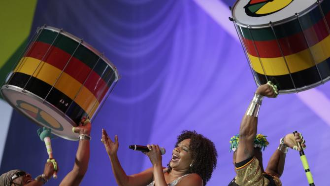 Menezes performs during the draw for the 2014 World Cup in Sao Joao da Mata