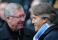 Manchester United manager Alex Ferguson (L) talks to Manchester City manager Roberto Mancini (R) at The Etihad stadium in Manchester on December 9, 2012. Wariness of UEFA's Financial Fair Play (FFP) rules and concerns about a lack of value in the market mean the Premier League's top clubs will proceed with caution when the January transfer window opens next week