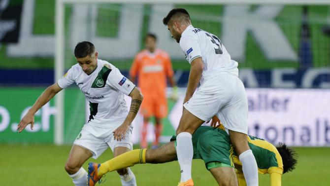 FC St. Gallen's Mario Mutsch, left, and Dejan Janjatovic, right, challenge  for the ball with Kuban Krasnodar's Ivelin Popv, center, during their UEFA Europa League Group A soccer  match between Switzerland's FC St. Gallen and Russia's Kuban Krasnodar at the AFG Arena in St. Gallen, Switzerland, Thursday, Sept. 19, 2013