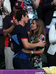 Andy Murray (L) embraces his girlfriend Kim Sears after beating Switzerland's Roger Federer in their men's tennis singles final at the London Olympics on August 5. Before heading to the Toronto Masters, Murray plans to enjoy a long night's celebration with Sears, his family and backroom staff