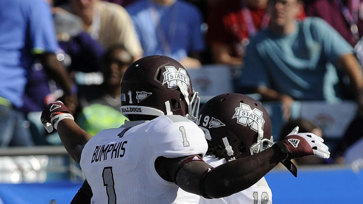 Mississippi State wide receivers Arceto Clark (19) and Chad Bumphis (1) celebrate Clark's touchdown catch against Northwestern during the first half of the Gator Bowl NCAA college football game, Tuesday, Jan. 1, 2013, in Jacksonville, Fla. (AP Photo/Stephen Morton)