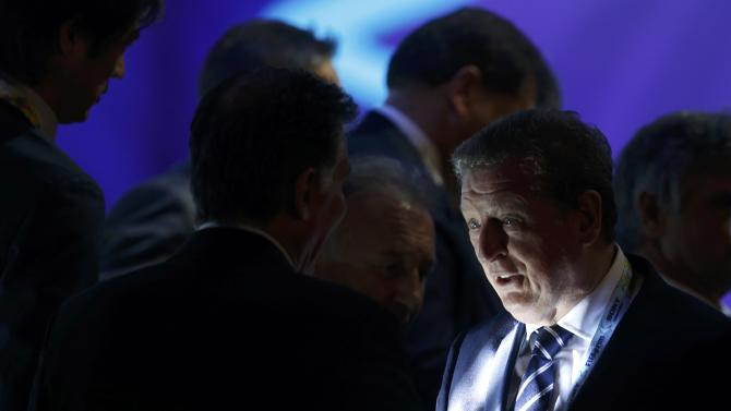 Hodgson chats with soccer coaches during the draw for the 2014 World Cup in Sao Joao da Mata