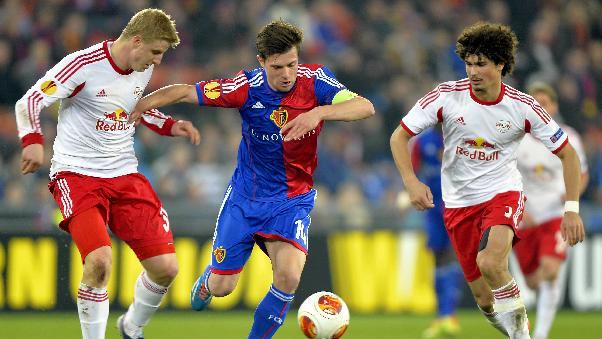 Basel's Valentin Stocker, center, is challenged by Salzburg's Martin Hinteregger, left, and Andre Ramalho during the Europa League round of sixteen first leg soccer match between Switzerland's FC Basel and Austria's FC Salzburg at the St. Jakob-Park stadium in Basel, Switzerland, on Thursday March 13, 2014