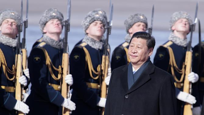 Chinese President Xi Jinping reviews honor guards shortly upon his arrival at the government airport Vnukovo II, outside Moscow, Russia, on Friday, March 22, 2013. Russia is Xi Jinping's first foreign destination as China's president. Xi's talks with Putin on Friday are set to focus on oil and gas as China seeks to secure new energy resources to fuel its growing economy. (AP Photo/Ivan Sekretarev)