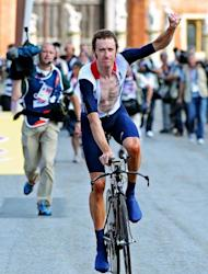 Britain's Bradley Wiggins celebrates winning the gold medal after competing in the London 2012 Olympic Games men's individual time trial road cycling event in London