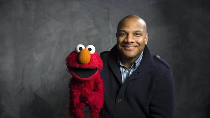 """FILE - In this Jan. 24, 2011 file photo, Elmo puppeteer Kevin Clash poses with the """"Sesame Street"""" muppet in the Fender Music Lodge during the 2011 Sundance Film Festival in Park City, Utah. The man who accused Clash of having sex with him when he was a teen now says it isn't so. The man said in a statement released on Tuesday, Nov. 13, 2012 that his sexual relationship with Clash was adult and consensual. (AP Photo/Victoria Will, File)"""