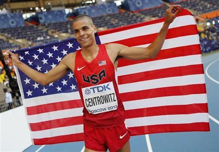 Centrowitz of the U.S holds up his national flag as he celebrates winning second place in the men's 1500 metres final during the IAAF World Athletics Championships at the Luzhniki stadium in Moscow