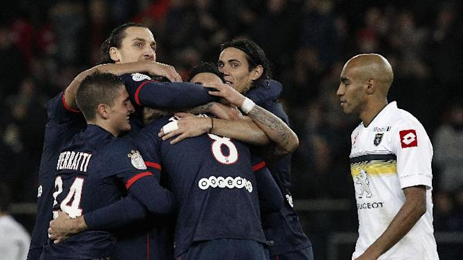 Paris Saint Germain's forward Zlatan Ibrahimovic from Sweden, left, and forward Edinson Cavani from Uruguay, center, celebrates the goal from Ezequiel Lavezzi from Argentina during their French League one soccer match against Sochaux at the Parc des Princes stadium, in Paris, Saturday, Dec. 7, 2013