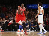 Luol Deng of the Chicago Bulls celebrates after hitting a shot in the second half against the New York Knicks at Madison Square Garden on December 21, 2012 in New York City. The Bulls defeated the Knicks 110-106