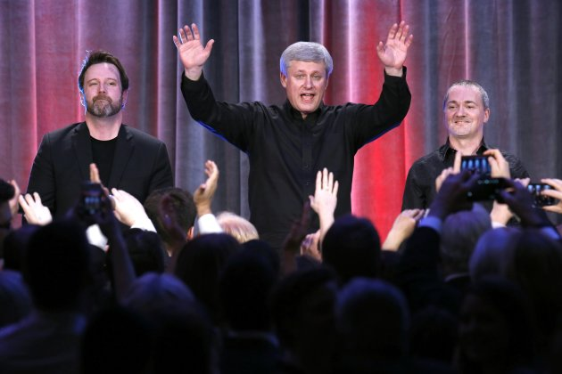 Prime Minister Stephen Harper waves to the audience after performing with his band on Dec. 9, 2014. (Reuters)