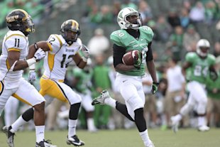 Marshall running back Steward Butler (20) breaks away from Southern Mississippi defenders Kalan Reed (11) and Emmanuel Johnson (12) for a touchdown during an NCAA college football game at Joan C. Edwards Stadium, Saturday, Nov. 2, 2013, in Huntington, W.Va. (AP Photo/The Herald-Dispatch, Marcus Constantino)
