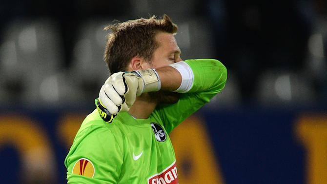Goal keeper Oliver Baumann of Freiburg reacts after Slovan scored the 2-2 during the UEFA Europa League Group H   soccer match between SC Freiburg and Slovan Liberec FC in Freiburg, Germany,  Thursday Sept. 19, 2013
