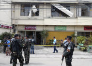 Philippine soldiers stand guard outside the Red Palm Pension House in the southern port city of Zamboanga, Philippines, following a bomb blast inside one of its rooms on Sunday, Oct. 9, 2011. Suspected homemade bombs exploded in a budget hotel and at a cockfighting arena wounding several people, officials said. (AP Photo/Al Jacinto)