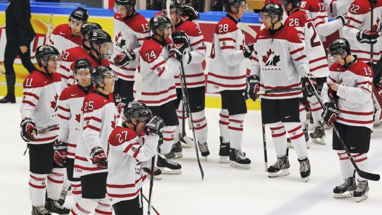 Canada reacts after their loss to Russia following their IIHF World Junior Championship bronze medal ice hockey game in Malmo