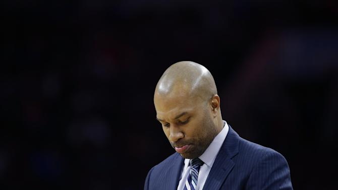 FILE - In this Friday, March 20, 2015, file photo, New York Knicks head coach Derek Fisher stands on the sideline during an NBA basketball game against the Philadelphia 76ers, in Philadelphia. Fisher was fired as New York Knicks coach Monday, Feb. 8, 2016, with his team having lost five straight and nine of 10 to fall well back in the Eastern Conference playoff race. (AP Photo/Matt Slocum, File)