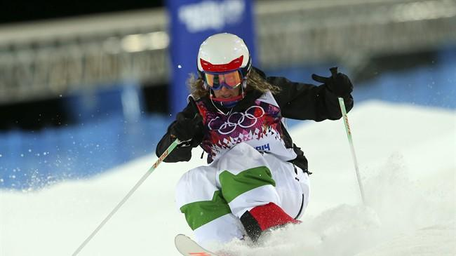 Italy's Deborah Scanzio competes in the women's moguls final 1 at the Rosa Khutor Extreme Park, at the 2014 Winter Olympics, Saturday, Feb. 8, 2014, in Krasnaya Polyana, Russia.(AP Photo/Sergei Grits)
