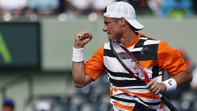 Tennis - Battling Hewitt scraps way to milestone 600th career win