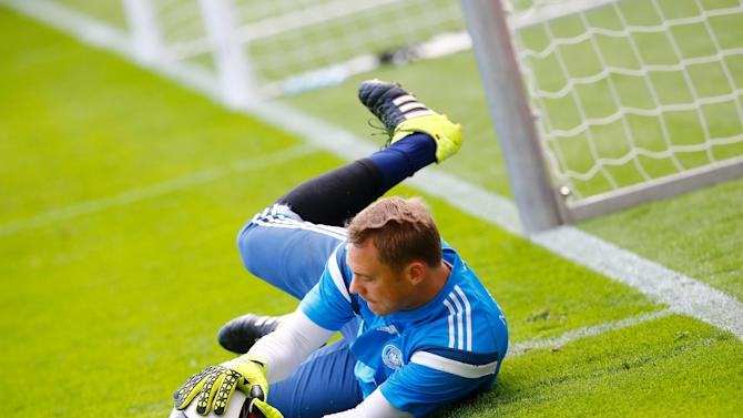 Neuer, goalkeeper of the German national soccer team dives for the ball a training session in Frankfurt