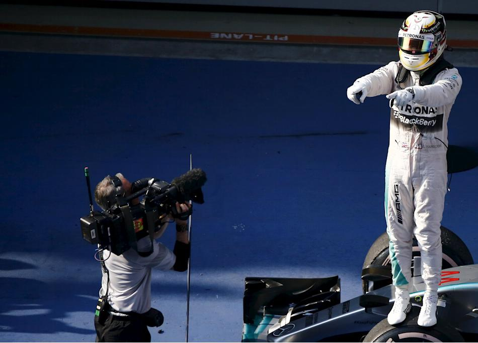 Mercedes Formula One driver Hamilton of Britain celebrates his victory after the Chinese F1 Grand Prix at the Shanghai International Circuit