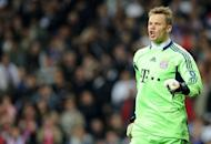 Bayern Munich's goalkeeper Manuel Neuer celebrates after saving a penalty during the UEFA Champions League second leg semi-final football match against Real Madrid at the Santiago Bernabeu stadium in Madrid on April 25. Neuer's key saves in Madrid helped put Bayern into the final, inspiring words of love from his chairman amidst signs he may have begun to win over the club's hard-core fans