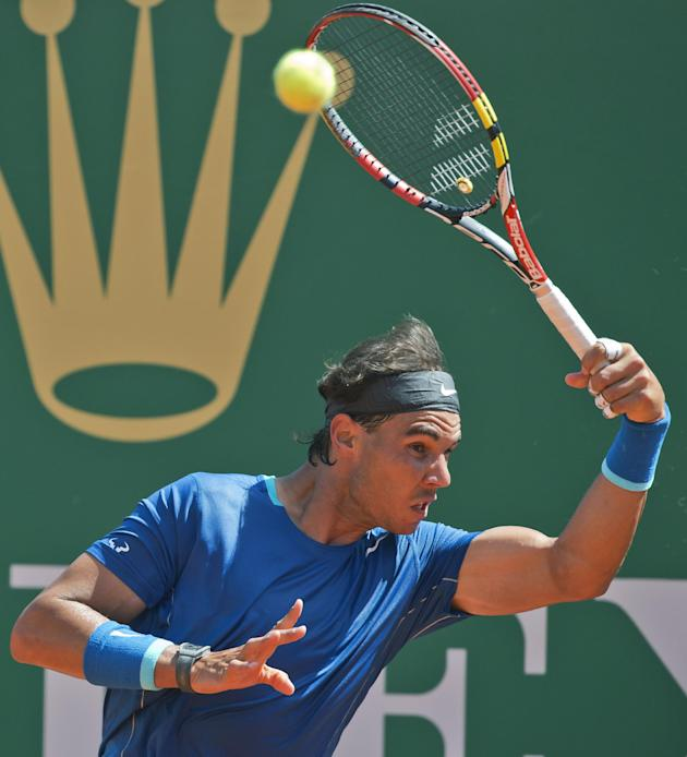 Rafael Nadal of Spain, returns the ball to Andreas Seppi of Italy, during their third round match of the Monte Carlo Tennis Masters tournament in Monaco, Thursday, April 17, 2014. Nadal won 6-1 6-3