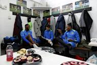 Sutton United players sit in the dressing room ahead of a team training session and media day at The Borough Sports Ground in Sutton, south-west London, on February 16, 2017